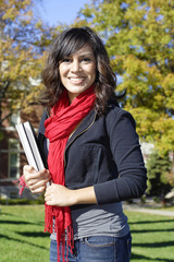 Female Latino college student on campus