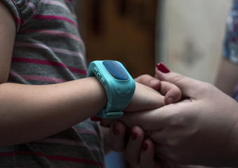 GPS smart kids watch on a hand little girl.