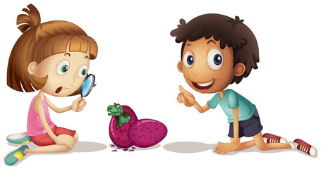 Children looking at dinosaur hatching eggs