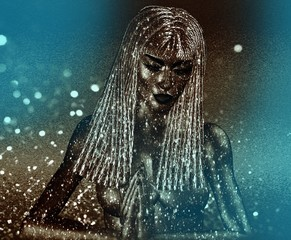 Meditation. Blue glitter bokeh and sparkles create an abstract effect for this beautiful Spiritual Goddess