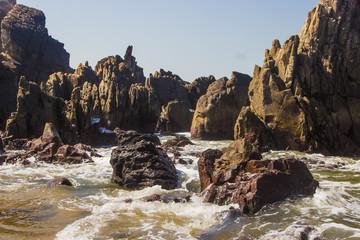 Arabian Sea, North Goa, India, stones on the foreground