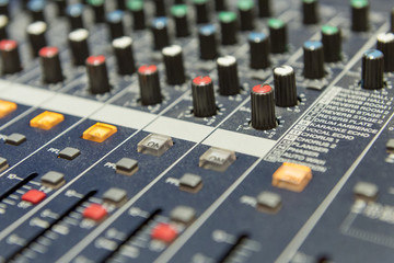 close up to the mixer table or fader board for music production process