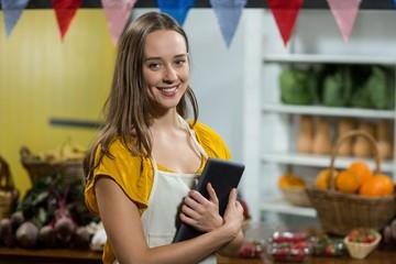 Woman vendor holding digital tablet