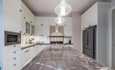 Kitchen island in modern new kitchen interior