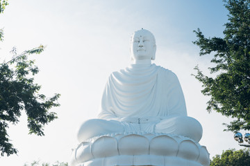 White Buddha Statue at Long Son Pagoda. Big Buddha Statue in Nha Trang, Vietnam. Sunny day, blue sky
