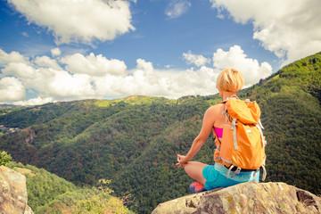 Hiking woman celebrating inspirational mountains landscape