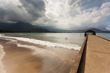 Hanalei Bay on an overcast morning with pier and mountains