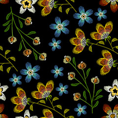 Cornflowers embroidery seamless pattern. Beautiful spring flowers on black background
