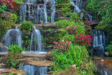 beautiful landscaping with waterfall and flowers