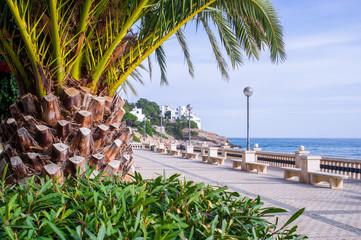 The walking path along the seashore of Sitges, Barcelona, Spain