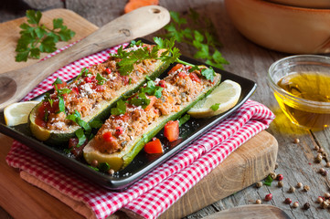 Zucchini stuffed with meat and vegetables