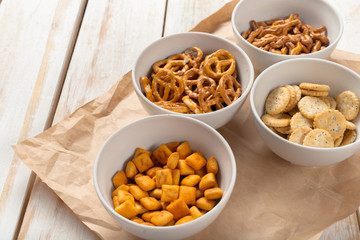 Pretzels in bowls on wooden table from above