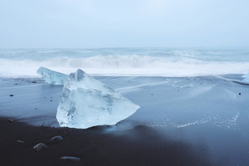 Ice Blocks on Black Wet Sand