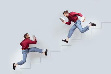 Two funny twin men with books running up and down