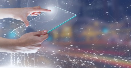 Hand touching glass tablet against Night city with connectors