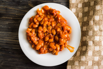 Beans in tomato in a white plate. A delicious dish.