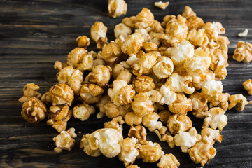 Sweet popcorn on a wooden table. Delicious dessert.