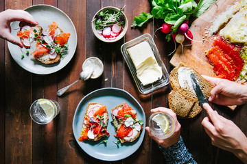 Making cured salmon open sandwiches
