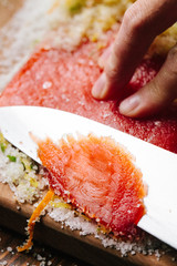 Slicing cured salmon