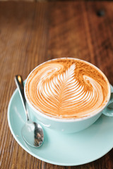 Cup of latte with froth art