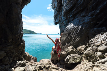 Travel women so ralax and happy in a cave near the sea in Keo Sichang, Thailand