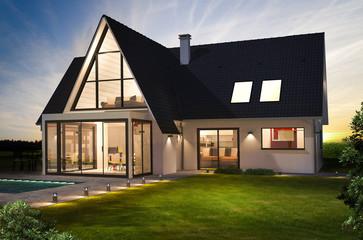 Belle maison moderne de nuit avec piscine