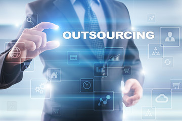 Businessman selecting outsourcing on virtual screen.
