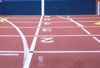 The start and finish line at an indoor track