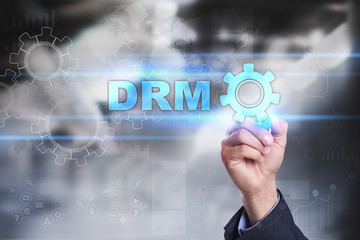 Businessman is drawing on virtual screen. drm concept.