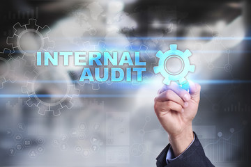 Businessman is drawing on virtual screen. internal audit concept.