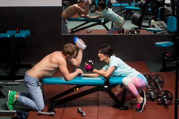 arm wrestling muscular man and girl at gym