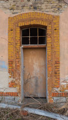 Part of the old building with door.