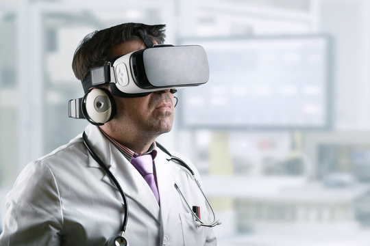 Doctor with virtual reality glasses / Doctor wearing virtual reality glasses conducting a remote clinical consultation