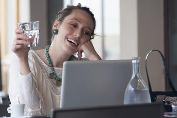 girl at bar seen computer