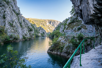 View of beautiful tourist attraction, lake at Matka Canyon in the Skopje surroundings, Macedonia. Hiking trail along side the mountain.