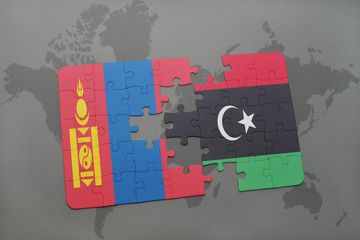 puzzle with the national flag of mongolia and libya on a world map