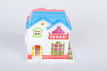 Plastic toy house on white background