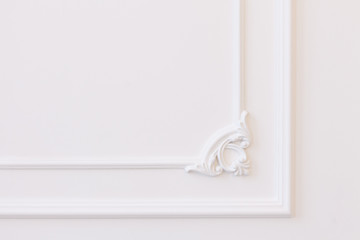 White wall decorated with stucco and molding in the style of Renaissance, Baroque.