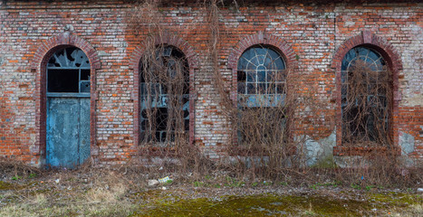 Part of building with door and windows.