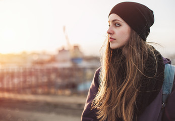 Portrait of a thoughtful hipster girl at sunset