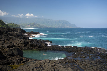 The Queens Bath near Princeville, looking towards Na Pali Coast, Kauai, Hawaii