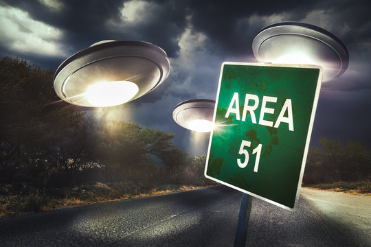 Area 51 sign on a road with dramatic lighting