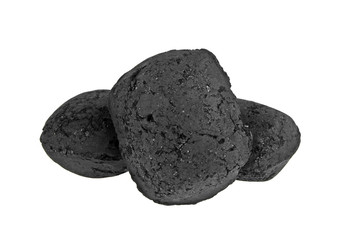 Heap of charcoal briquettes on white background
