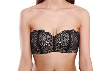 Graceful slim woman posing in black bra