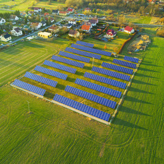 Aerial photo of solar power plant. Photovoltaic power station supplying electricity to small town in countryside.