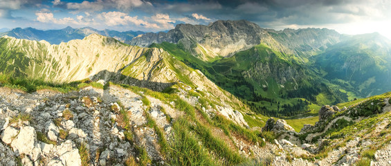 Wall Mural - Great panoramic view to mountains and valley in summer light