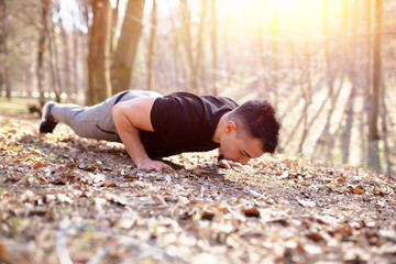 Man doing push ups, exercise in nature