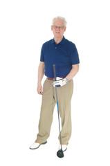 Senior man standing with golf iron.