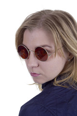 Young woman in sunglasses round glasses