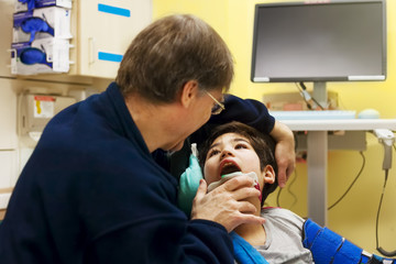 Disabled little boy in doctor's office getting check up